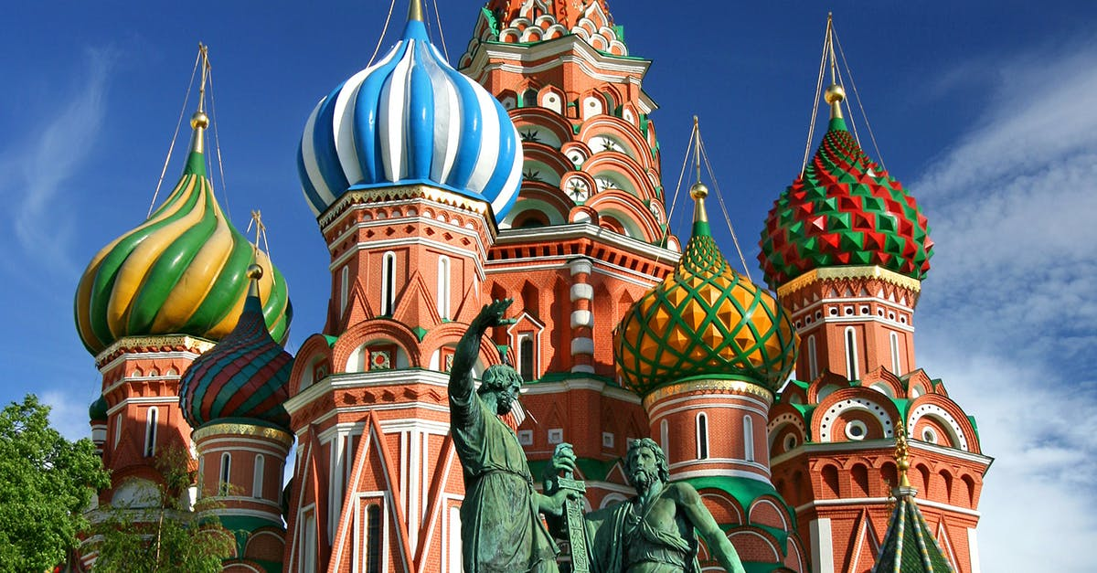 A large building with Saint Basil's Cathedral in the background